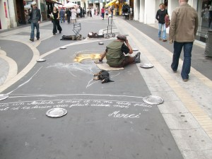 Chalk artist with dog