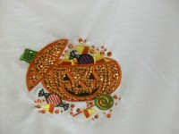 Quelle horreur!  Applique pumpkin's candy brains are spilling out all over the place!