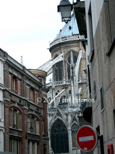 Sneaking up on Notre Dame, Paris.  Even from the back, and down the street, it's imposing.