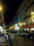 Paris street, Latin quarter, at night.  I don't know whether to laugh or cry over Johnny Whitepants, but he really makes this picture.