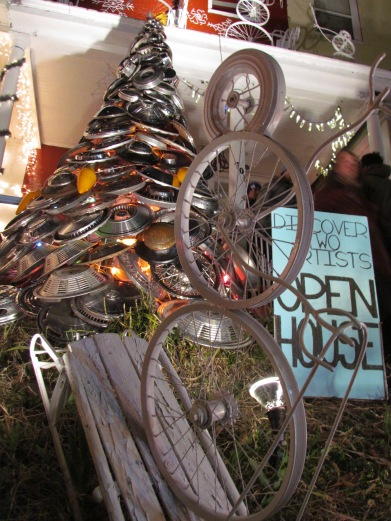 Bike sculpture in front of the hubcap tree.  Dream. Come. True.