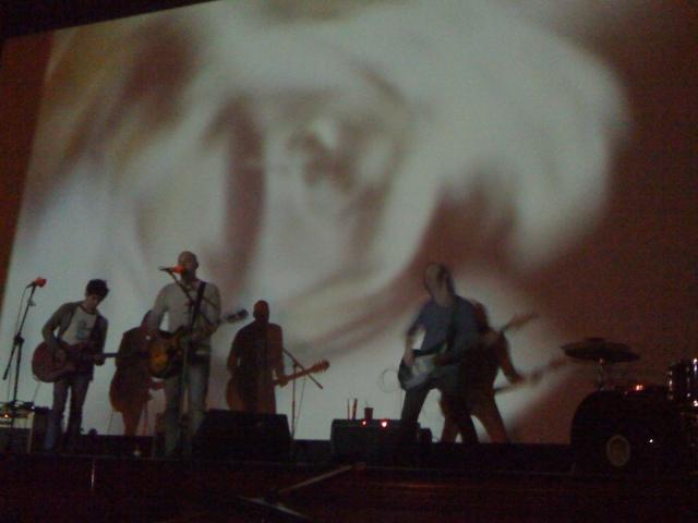 Shadowy men playing moody music.