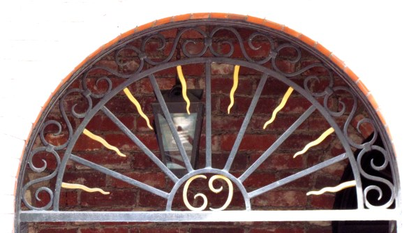 No, I didn't crop this photo. The front of the building was washed out in a blast of afternoon sun, but the door and accompanying grillwork were recessed and in photo-friendly shadow.