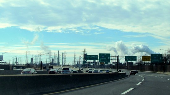 Cars and smokestacks, far as the eye can see.